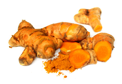 Image of raw and ground turmeric