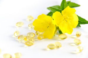 evening primrose oil capsules, one example of natural period pain remedies