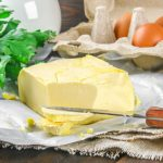 Cholesterol containing foods - image of butter and eggs