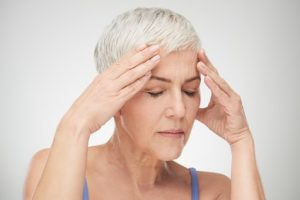 Woman having a migraine headache